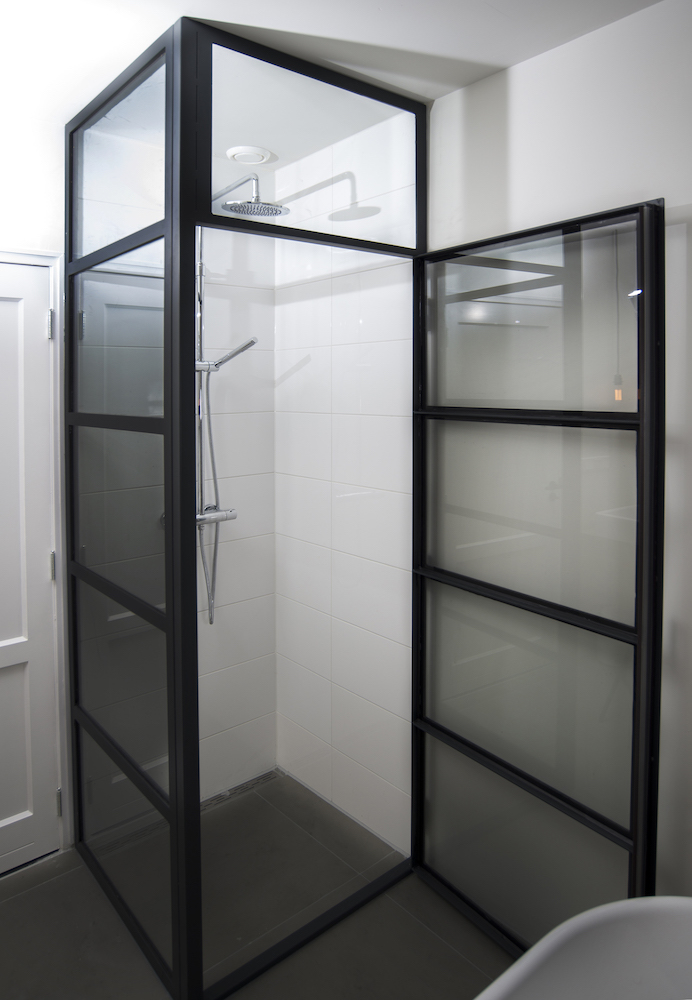 Custom made shower cabin of black steel and glass